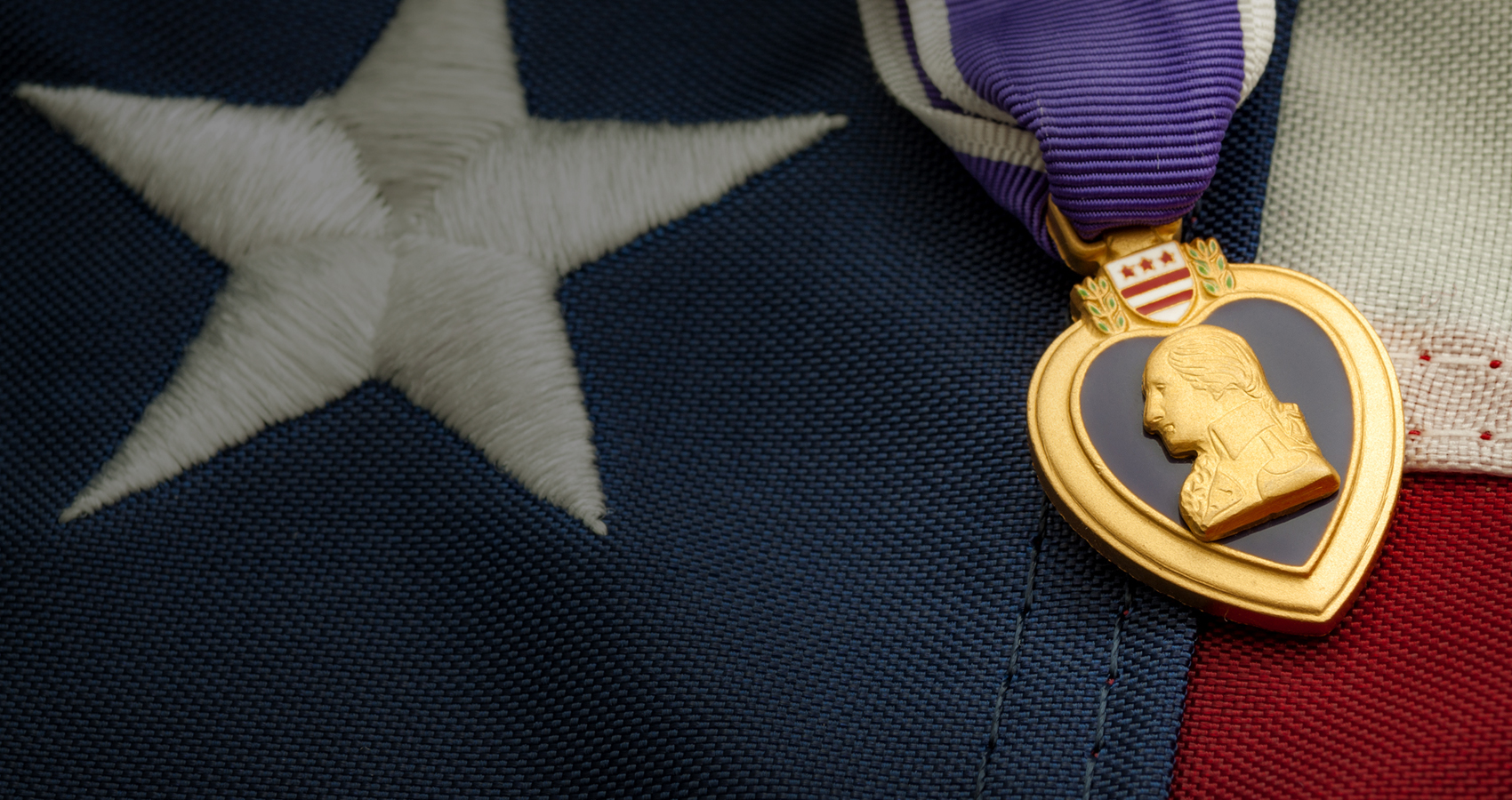 Image of Purple Heart Medal and American flag for the Military decorations website search database